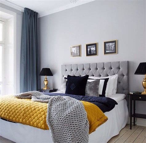 grey and blue decor with yello pop of color bedroom