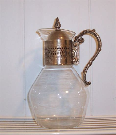 vintage glass pitcher with silver vintageway
