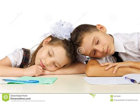 Student Sleeping On Desk by Students Are Sleeping On The Desk Stock Photography