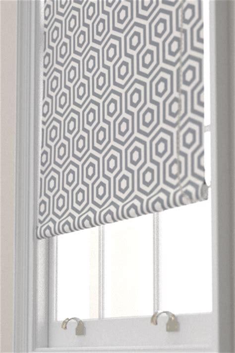 geometric pattern roller blind hex by prestigious stone grey wallpaper direct