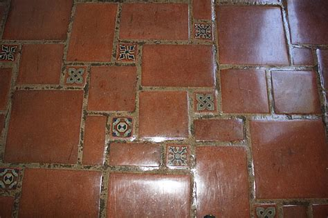 decorative tiles as inserts in terracotta clay pavers