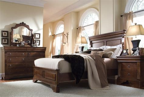 modern brown wood bedroom furniture set on the grey rug