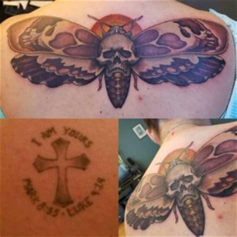 tattoo shops eureka ca bohemian cross covered with moth