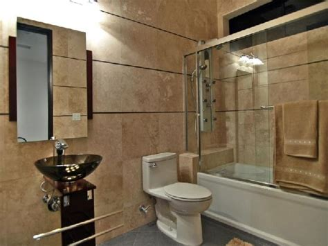 toilet in bathtub wiht glass wall design at contemporary