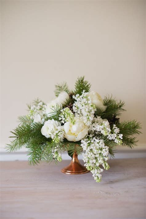 25 best ideas about winter flower arrangements on
