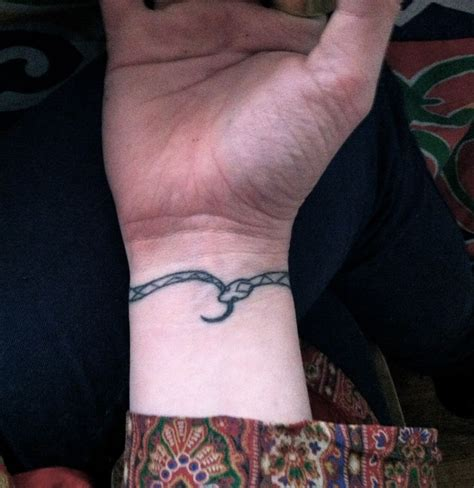 snake tattoo on wrist ouroboros bracelet beauticianary a