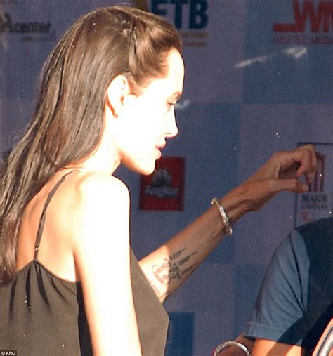 angelina jolie upper arm tattoo angelina jolie debuts new tattoos and directs khmer rouge