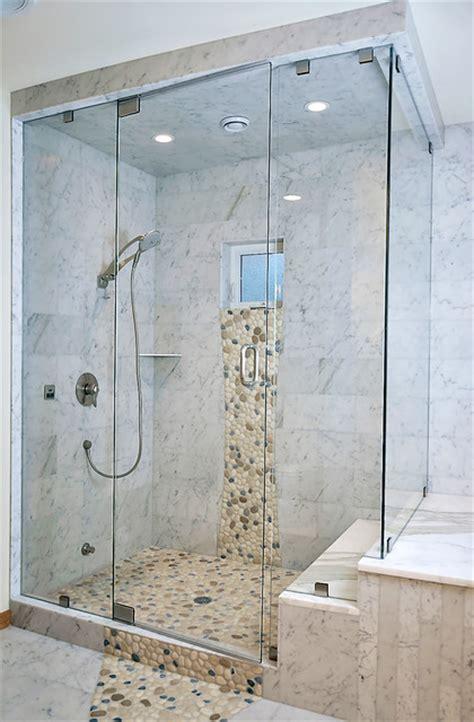 carrara marble shower  river rock pebbles