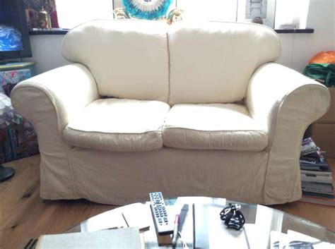 comfy two seater sofa freelywheely comfy two seater sofa in cream removable covers