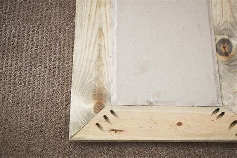 attaching the frame to your mirror diy reclaimed wood mirror honeybear lane