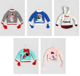 black doll collecting christmas sweater ornaments
