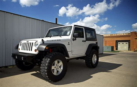 stock jeep vs lifted jeep jeep wrangler rubicon 3 5 inch lift 35 inch tires not