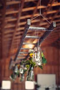 hanging a ladder from the ceiling upcycled ladder shelves and creative display ideas