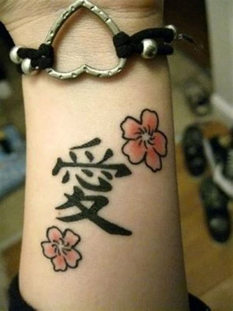 chinese tattoo on wrist symbol and flower on wrist
