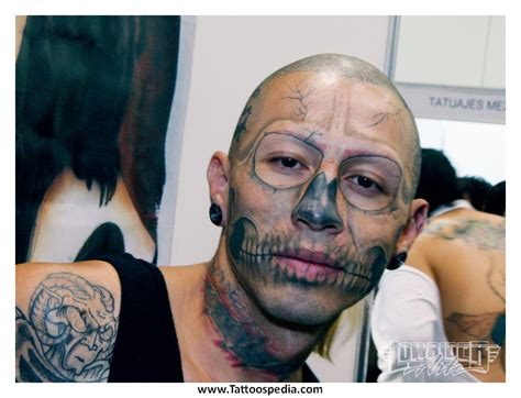 cross on face tattoo meaning does cross your 2