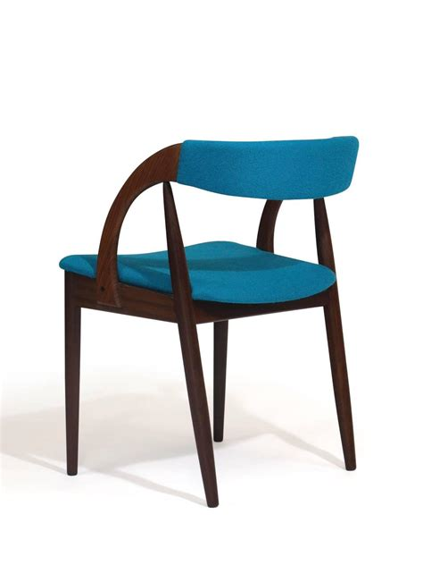 mid century walnut dining chairs in turquoise at