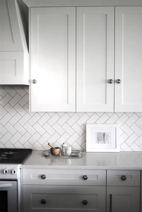 Backsplash For White Kitchens Remodeling Subway Tiles Backsplash White Tile Pattern Glossary Laid In A Herringbone Pattern