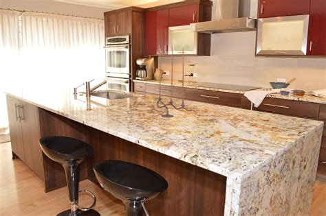 kitchen island with granite a quot waterfall quot edged granite island is fabricated for a clean modern look scandinavian kitchen