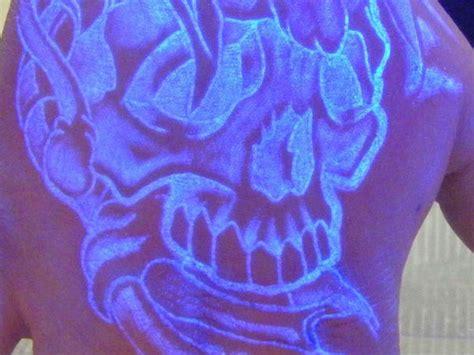cheshire cat tattoo uv ink skull light tattoo on back