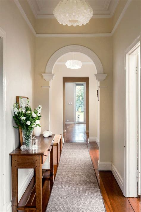 house hallway hallway with arch breaking up the space to enter