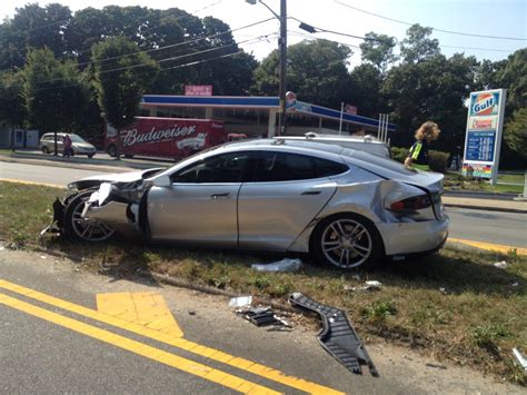 wrecked car tesla model s gets wrecked owner says vehicle saved his