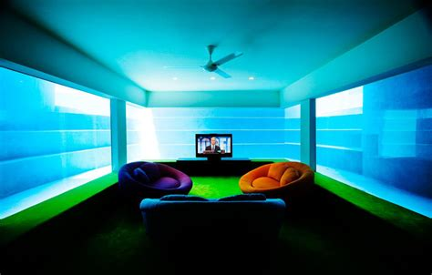 Seafront Home In Singapore With Underwater Media Room | fish house seafront home with underwater media room in