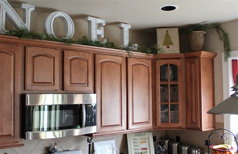 Garland Above Kitchen Cabinets big letters and pine garland above the kitchen cabinets