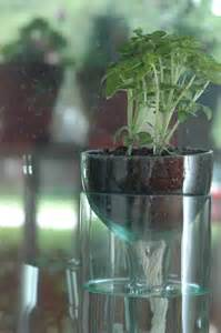 self watering planter made from recycled wine by