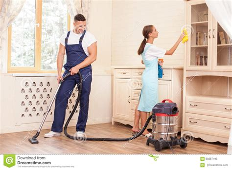 cleaning the house cheerful young workers are cleaning the house with stock image image 58587499