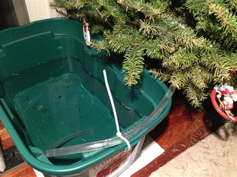 christmas tree stand with water reservoir leaving your tree for a days set up a reservoir of water with a siphoning