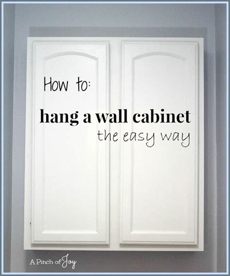 how to hang a picture how to hang a wall cabinet the easy way