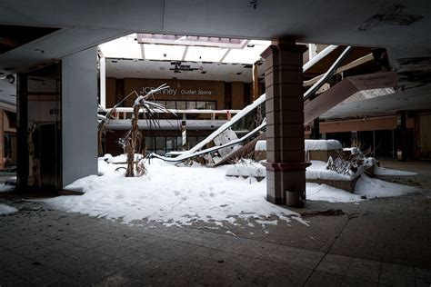 eerie photos of snow blanketing the interior of an photographer documents eerie abandoned mall covered in snow