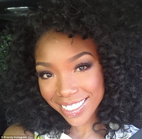 brandy the game hair cut brandy norwood displays her diy hair and make up look as