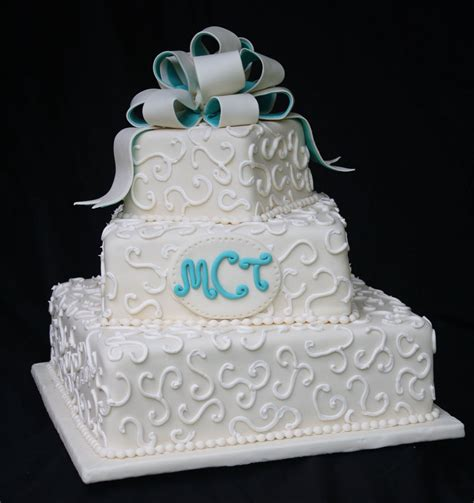wedding cakes an ivory and teal wedding cake