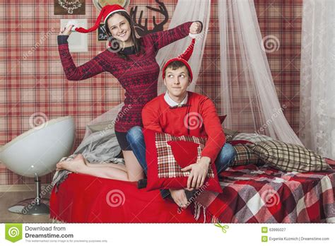 man and woman in the bedroom couple man and woman in the bedroom on the bed with a