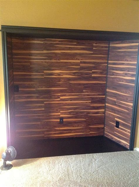 inset is complete on the wall we glued allure vinyl plank flooring in african wood dark and