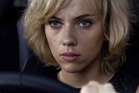 film lucy part 2 scarlett johansson and lucy pull the football away from