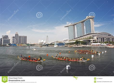 dream boat streaming dragon boats streaming into finish with mbs as backdrop