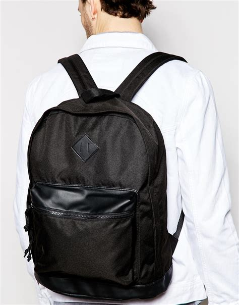 Aproncelemek Canvas And Synthetic Leather Black asos backpack in black with faux leather trim in black for lyst