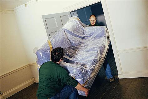 how to move a couch how to avoid extra fees when moving by wrapping your stuff