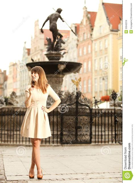 women in this town woman in old town gdansk neptune fountain royalty free stock photos image 33042218