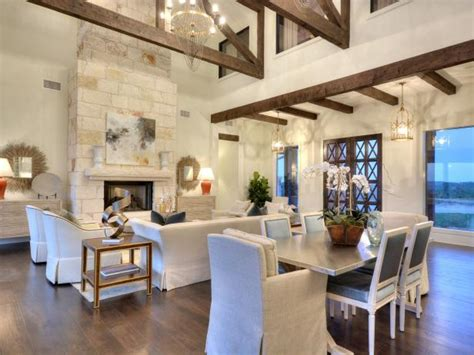 stunning great room features exposed beams stone