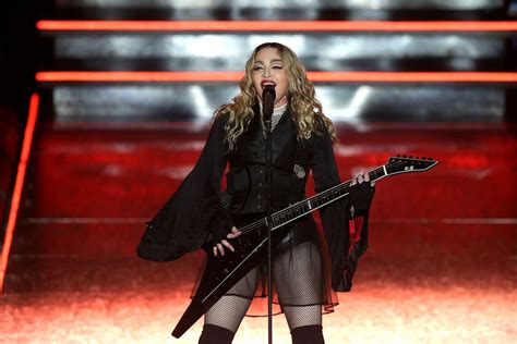 Pulls A Madonna by Madonna Pulls Fan S Top On Stage But Calls