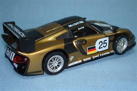 porsche slot car fly 1 32 porsche 911 gt1 evo 25 metallic gold mobil 1