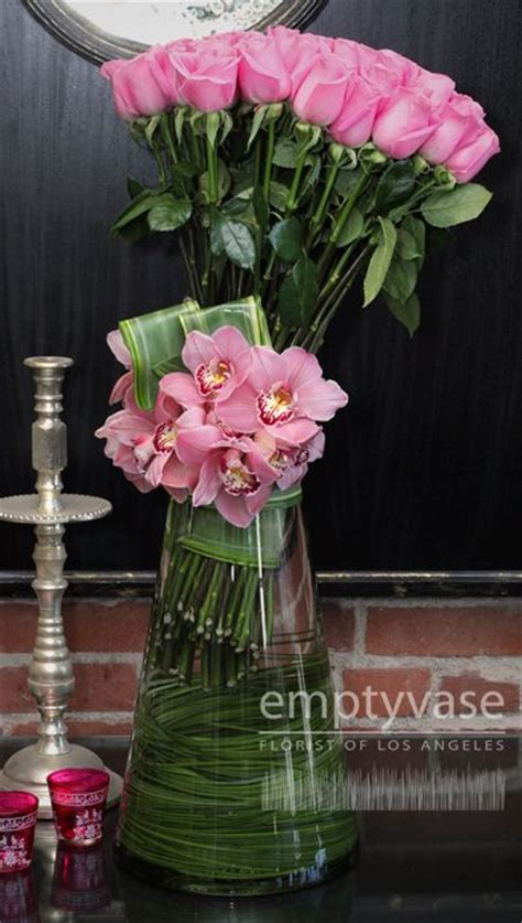 Empty Vase West by Side Cluster Of Pink Roses And Pink Cymbidium Orchids In