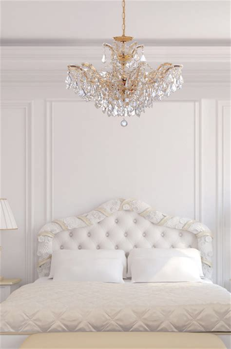 Bedroom Crystal Chandelier | maria theresa gold crystal chandelier in white bedroom