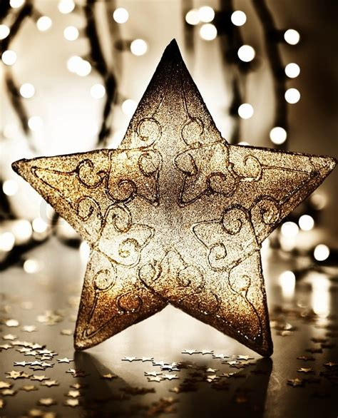 home decor star star christmas tree ornament golden decoration over blur