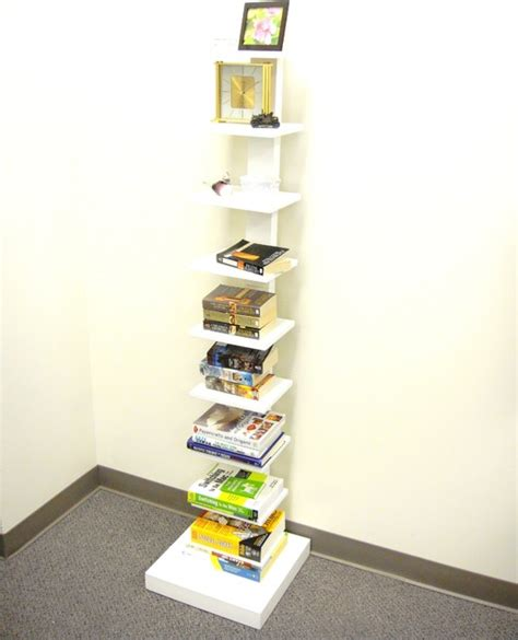 spine standing bookshelves white display and wall shelves