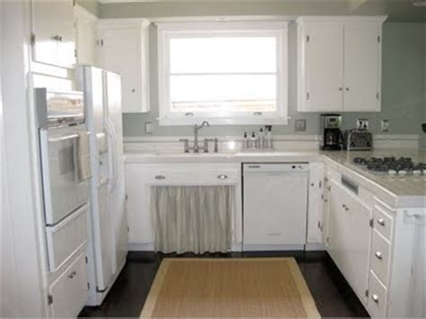 white kitchen cabinets with silver hinges silver knobs with white kitchen cabinets kitchen laundry