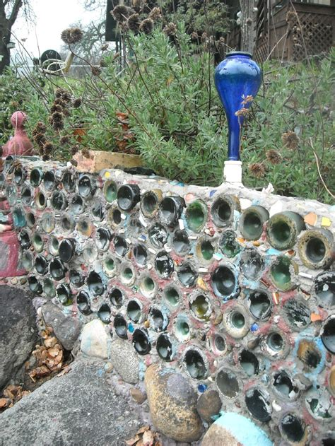 17 Best Images About Upcycled Bottles On Pinterest Wine Bottle Garden Wall